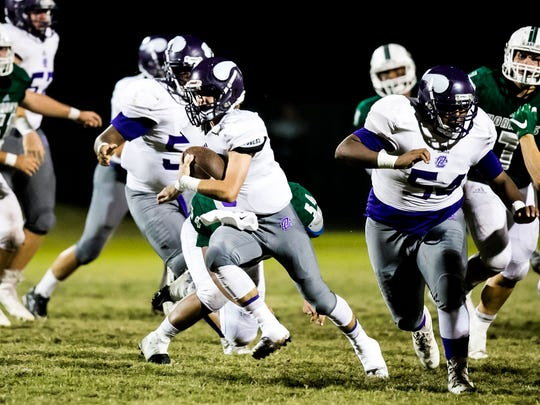 Opelousas Catholic quarterback Zach Mengarelli breaks free for yardage in the football game between the Vikings and Catholic High Point Coupee in New Roads Friday Nov. 3, 2017.