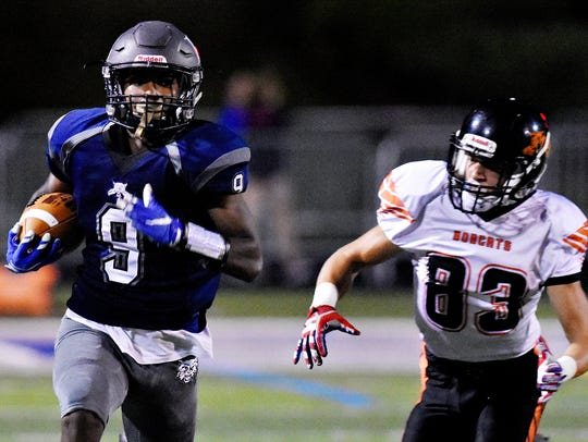 Dallastown's Nyzair Smith, left, runs the ball in for