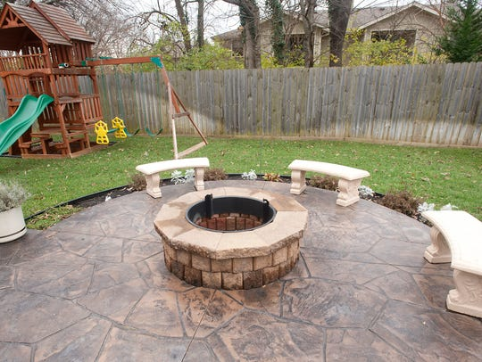 A fire pit allows outside entertaining in the back