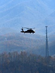 An Army National Guard helicopter flies over Gatlinburg