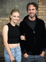 Amanda Seyfried and Thomas Sadoski attend the Givenchy