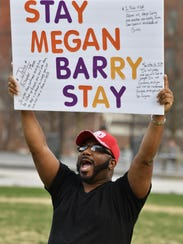 """Demetrius Rowe holds a sign that says, """"Stay Megan"""