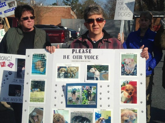Shawn Coyte holds a poster with photographs of abused and neglected dogs animal welfare advocates say have been rescued on the Eastern Shore of Virginia. Coyte was one of nearly 20 protestors who rallied outside the Accomack County General District Courthouse in Accomac, Virginia on Monday, March 6, 2017 before a hearing in an animal cruelty case.