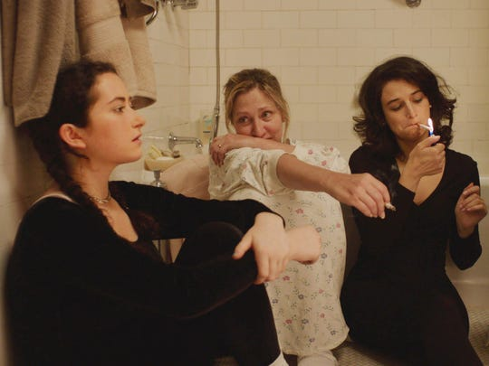 Abby Quinn, left, Edie Falco and Jenny Slate uncover