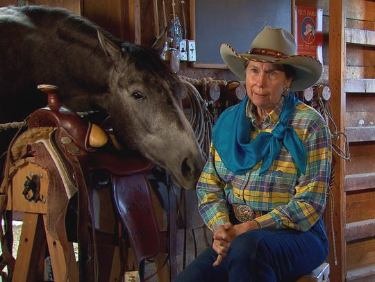 Jane Lambert being interviewed in the barn with her