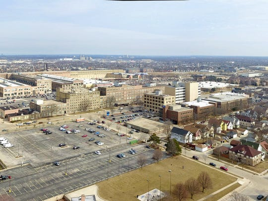 "A ""before"" aerial view shows 70h Street in front of"
