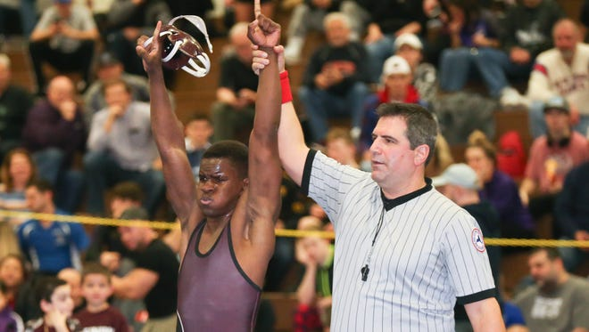 Ossining's Zachary Bonner defeats Scarsdale's Seth Schulman in the 138-pound match at the Section 1, Division 1 wrestling finals at Clarkstown High School South in West Nyack on Sunday, February 11, 2018.
