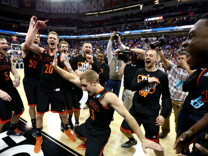 RALEIGH, NC - MARCH 21:  Kevin Canevari #3 of the Mercer Bears celebrates with teammates after defeating the Duke Blue Devils 78-71 during the Second Round of the 2014 NCAA Basketball Tournament at PNC Arena on March 21, 2014 in Raleigh, North Carolina.
