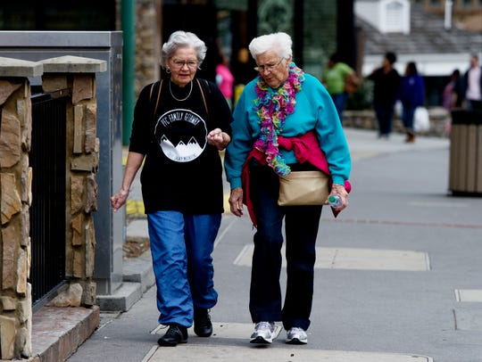 Two ladies walk down The Parkway 90 days after the