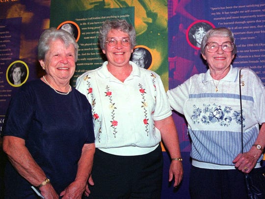 In this Aug. 3, 1999, file photo. former women's professional baseball players Mary Pratt, left, of Quincy, Mass., and Maddy English, right, of Everett, Mass., are joined by their friend Marie Cronin, center, at the opening of the New England Women's Sports Hall of Fame in Saugus, Mass.