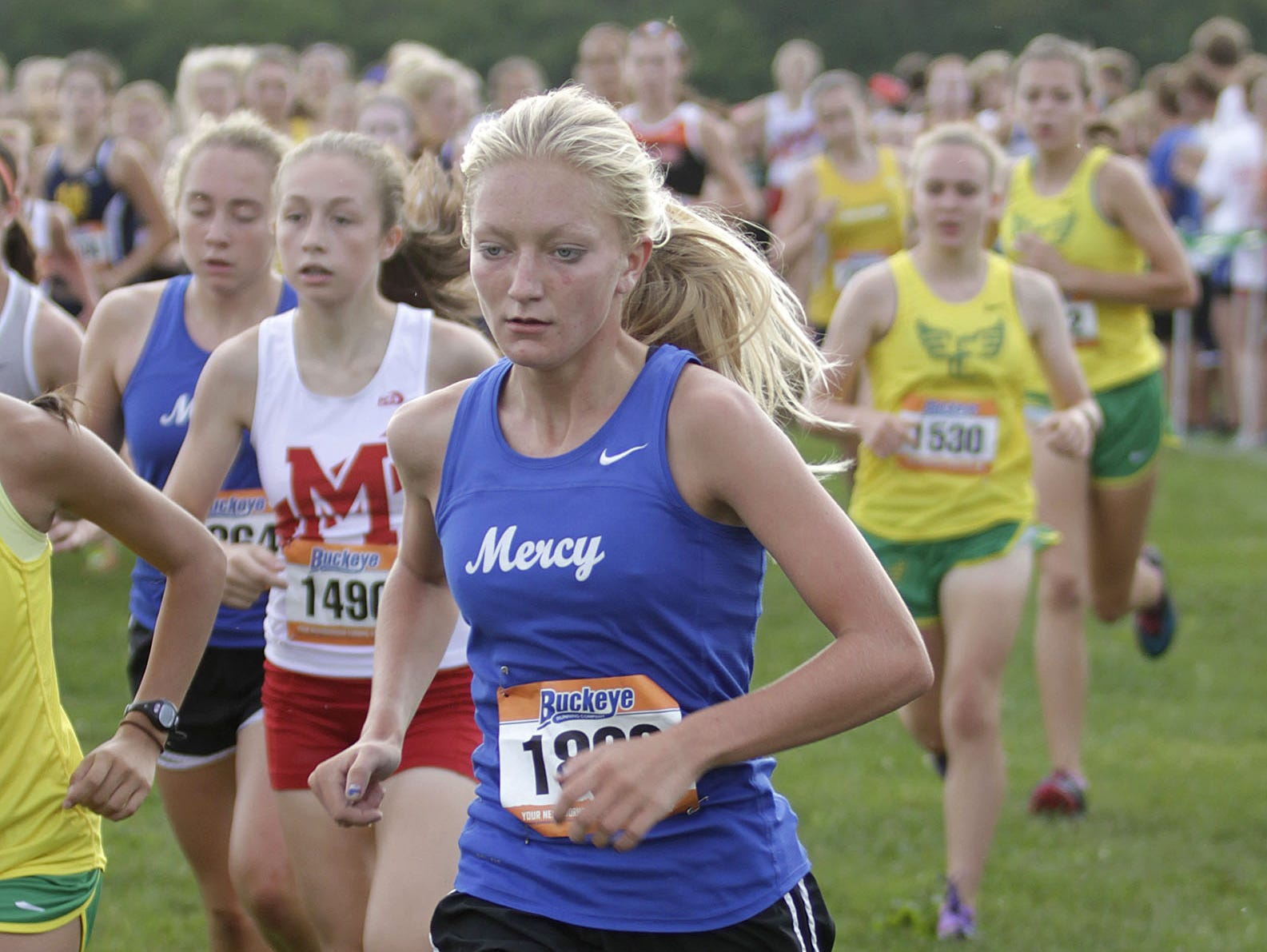 Mercy's Megan Zeinner runs at the Mason cross country invite this past season.