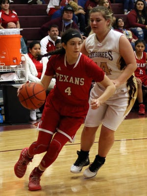 Ray's Brittany Colunga (4) drives past Tuloso-Midway's Alycen Hoelscher (14) during their District 30-5A North Zone Game in Bobby Craig Gymnasium on Tuesday, January 21, 2017.