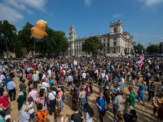 Demonstrators raise a effigy of Donald Trump, being dubbed the 'Trump Baby', in Parliament Square in protest against his visit to the United Kingdom.
