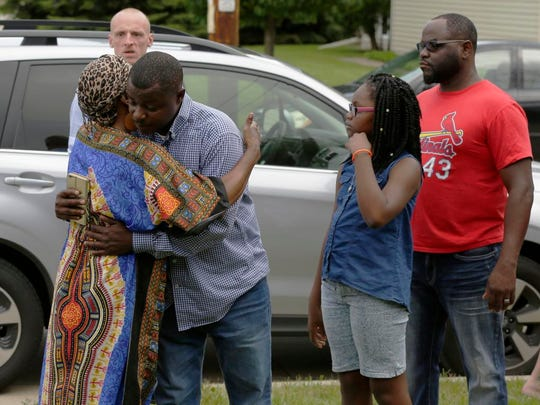 Rosie Harvey, grandmother of Isaiah Tucker, hugs Jeremy Flowers, Isaiah's uncle, at the end of a vigil on Aug. 5.