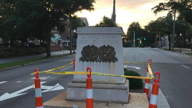 The statue of Confederate Attorney General George Davis at Third and Market streets downtown has been removed temporarily by the city of Wilmington over public safety concerns.