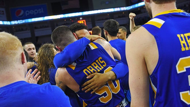 SDSU's Michael Orris (50) celebrates their their 79-77 win over Omaha with friends, family and teammates after the Summit League Tournament men's championship game Tuesday, March 7, 2017, at the Denny Sanford Premier Center in Sioux Falls.