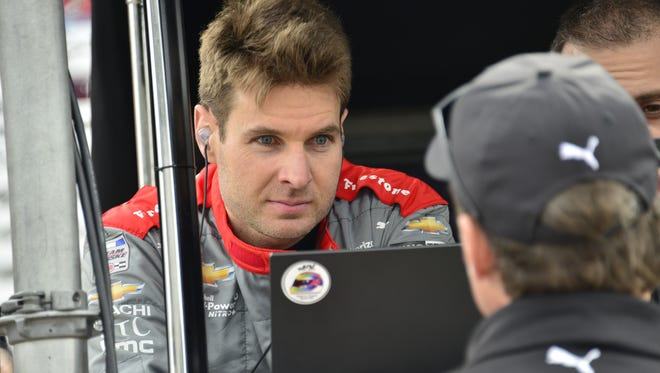 Will Power talking to Tim Cedric, Penske Racing team president, during morning practice prior to qualifying for the Indianapolis 500 at the Indianapolis Motor Speedway, Saturday, May 21st, 2016