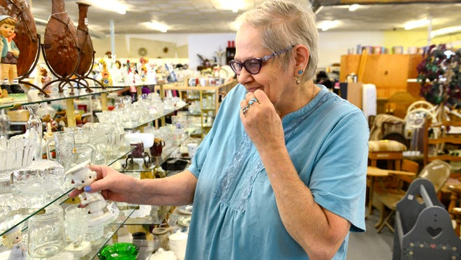 Elissa Nye of Green Springs looks for knickknacks at Share and Care in Fremont on Tuesday afternoon. Share and Care, on Bidwell Avenue, offers clothing and houseware items at low prices to area residents.