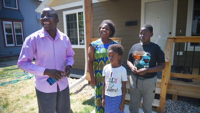 Ndaruzaniye Eliezel, left, his wife Francine, their daughter Nema and their son Audance stand out front of their home at 503 S. Summit Monday in Sioux Falls. The home is a part of an affordable housing project. Ndaruzaniye and Francine have four children, John and Sondrine not pictured.