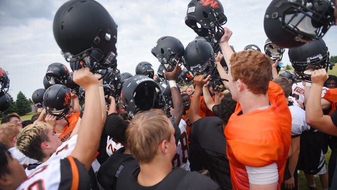 Washington coach Chad Stadem talks to his team after practice Friday, Aug. 11, at the high school football field in Sioux Falls.