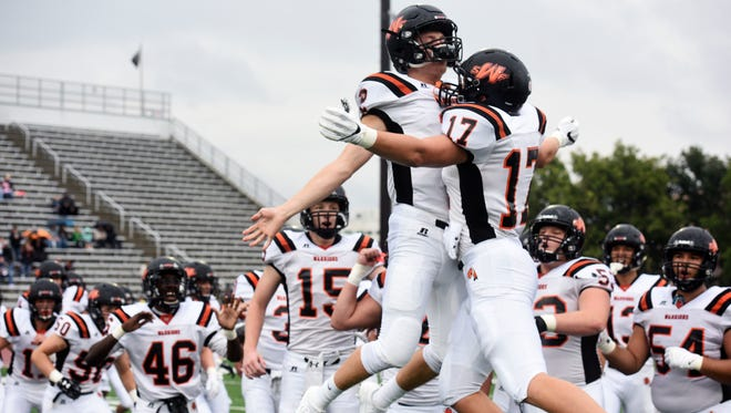 Washington quarterback Jayden Johannsen (2) chest bumps with tight end Seth Benson (17) during introductions before their high school football game on Friday Sept. 1, 2017, at Howard Wood Field in Sioux Falls.
