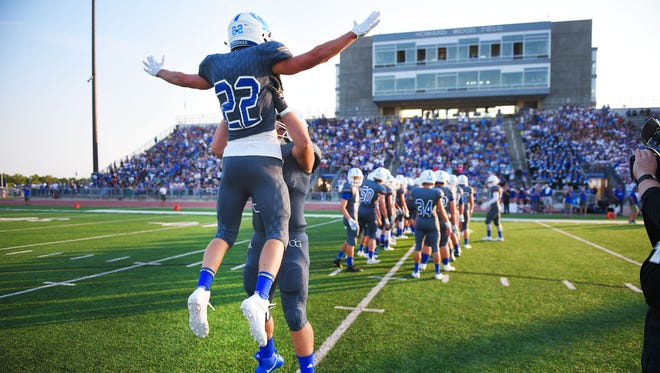 O'Gorman's Cole Howes is lifted up by a teammate as his name is announced at the beginning of the game.