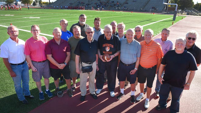 Members of 1967 state championship football team from Washington High gather Thursday, Sept. 28, at Howard Wood Field in Sioux Falls. The teams 50th anniversary reunion celebration is Friday night. Front row: Tom Nelson, Mark Scott, Darrel Tully, Jerry Burke, Dennis Thompson, Dick Day, Glen Nelson, Jim Luce, and Wayne Gullickson. Back row: Rich Hall, Jay Rood, John Moller, Mike Campbell, Gary Hanson, Chuck Haugland, Paul Halstenson and Ron Risty.