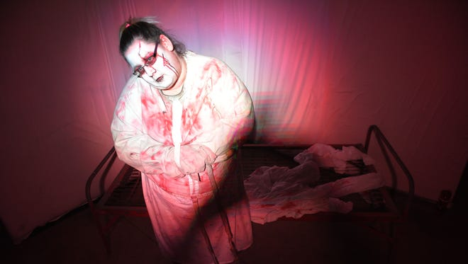 Tamika Larsen is one of the scares in Jaycees Haunted House Tuesday, Oct. 17, in Sioux Falls.