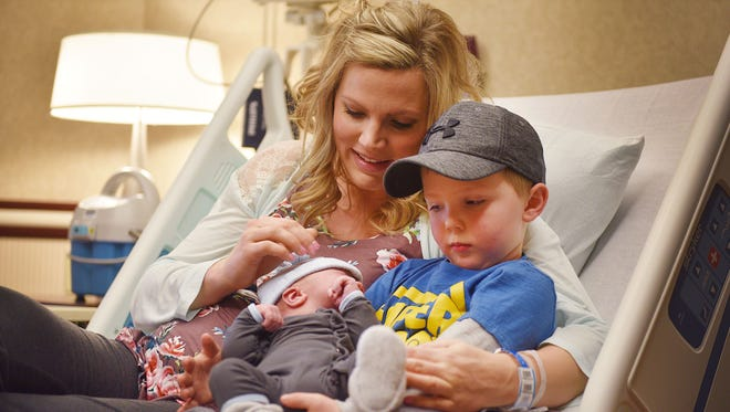 Malcolm Rogers, 4, looks at his new born baby brother, Jeremiah, with his mom Stephanie Rogers Monday, Jan. 1, at Sanford Health in Sioux Falls. Jeremiah was welcomed by his dad Nick Rogers and his other older brother Tobias, 2. Jeremiah was the first baby born at 12:32 a.m. at Sanford in 2018.