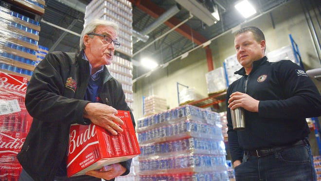 Sen. Jack Kolbeck, R-Sioux Falls, and Ed Beal, son of state Rep. Arch Beal, R-Sioux Falls talk about their standards for the beer they distribute at Beal Distributing Monday, Jan. 29, at their warehouse in Sioux Falls.