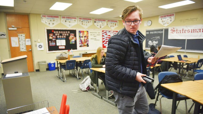 Lincoln High School Statesmen editor in chief Gage Gramlick prints out final copies of a bill he has been working on Tuesday, Feb. 6, during newspaper at the high school. Gramlick is set to testify in Pierre Wednesday on a bill he wrote barring school administrators from restraining student newspapers' content.