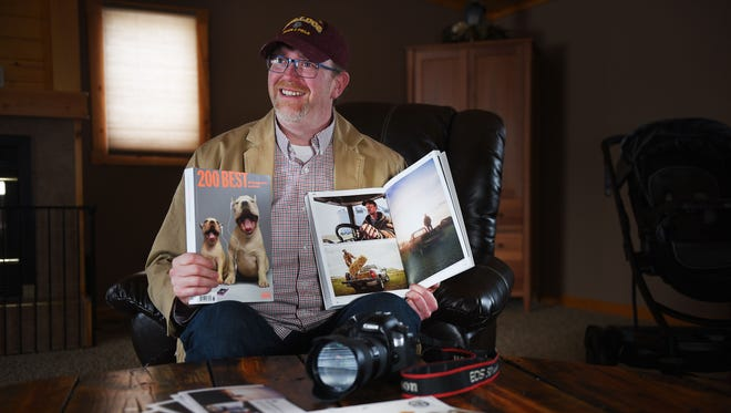 Photographer Robb Long talks about his work Saturday, Feb. 23, at his home in Garretson. Long was just named one of the top 200 advertising photographers in the world.