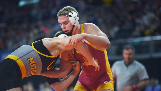 Roosevelt's Joey Otta wrestles Mitchell's Carson Max in the 2018 SDHSAA State Wrestling Championships Saturday, Feb. 24, at the Denny Sanford Premier Center in Sioux Falls.