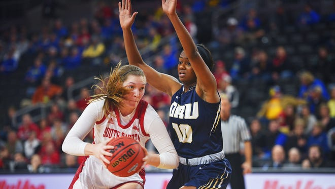 USD's Chloe Lamb goes against Oral Roberts' Maya Mayberry during the Summit League basketball tournament Monday, March 5, at the Denny Sanford Premier Center in Sioux Falls.