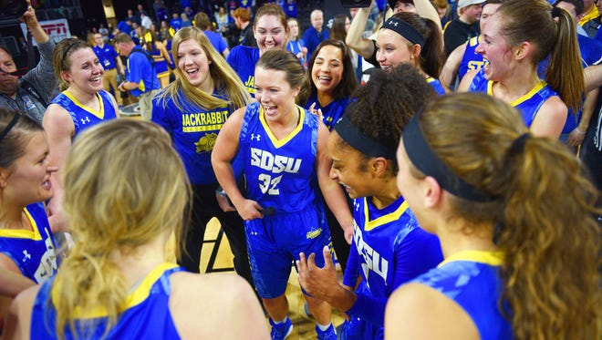 SDSU Sydney Palmer dances in the center of her team as they celebrate their win against USD Tuesday, March 6, during the Summit League basketball tournament at the Denny Sanford Premier Center in Sioux Falls.