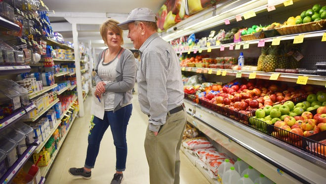 Sally Barnhart and Rusty Hiltunen talk in the produce aisle Tuesday, March 13, at Rusty's Food Store in Howard. Rusty played baseball in the area when he was younger. He said baseball wasn't going to pay his bills so he bought the store. Rusty's son, Rick Hiltunen, is the current owner of the store. Rusty's has been a staple in Howard since the 1950s.