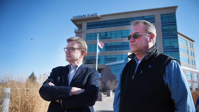 SculptureWalk director Jim Clark, left, and SculptureWalk public relations Jeff Hanson, right, look over the land where Arc of Dreams will be built Friday, March 30, in Sioux Falls.