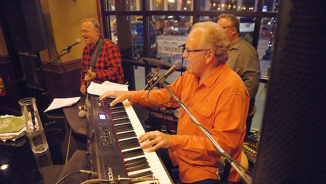 Denny Gale, Bill Hoffman and John Mogen, Mogen's Heroes, performs at Paramount Bar inside Minervas downtown Friday, March 30, at the restaurant. Mogen's Heroes is being inducted into the South Dakota Rock n Roll Hall of Fame.