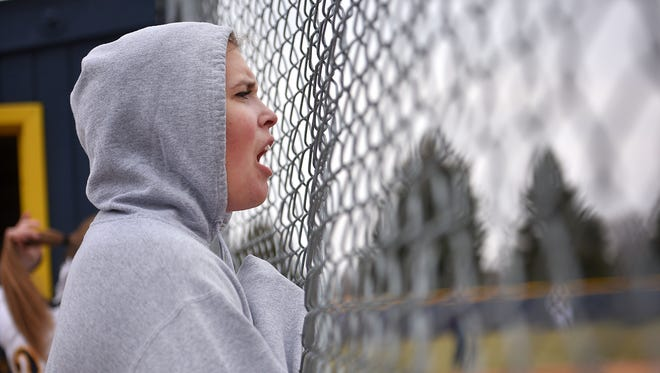 Augustana's Olivia Wolters wears a hoodie in the dugout during the softball game against Southwest Minnesota State Wednesday, April 11, at Bowden Field in Sioux Falls.