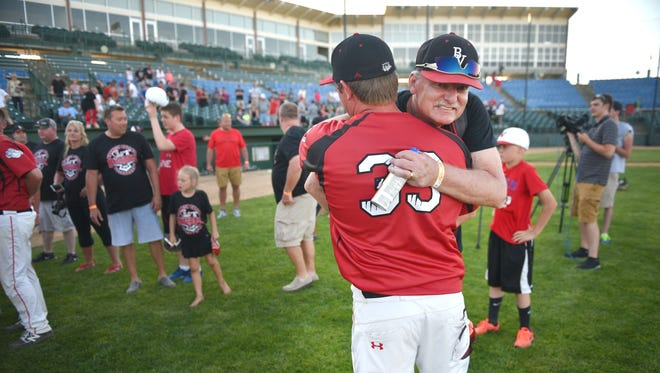 Brandon Valley coach Jeremy VanHeel is congratulated after the win against Pierre in the Class A state high school baseball championship Saturday, May 26, 2018 at Sioux Falls Stadium.