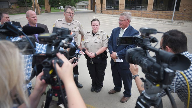 CEO of Redfield Community Memorial Hospital Avera Michael O'Keefe, from left, Spink County sheriff Kevin Schurch, Officer Jen Apple and Spink County Courthouse State's Attorney Vic Fischbach address the press outside of Redfield Community Memorial Hospital Avera Monday, June 25, in Redfield. Matthew James Mathern, 30, was inside the hospital with a 10-year-old before letting the 10-year-old go and surrendering peacfully.