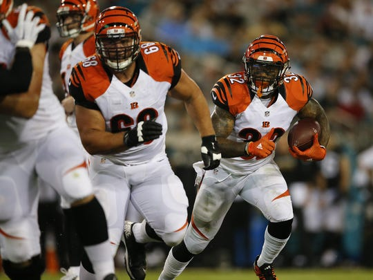 Cincinnati Bengals running back Jeremy Hill (32) looks for running room behind Cincinnati Bengals guard Kevin Zeitler (68).