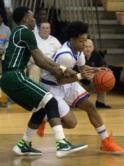 Yancey Kelly pushes past Marvin Robertson of Central