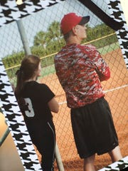 A picture of ECS senior Carly West and former coach