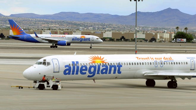 Jets from Las Vegas-based Allegiant Air taxi at McCarran International Airport in 2013.
