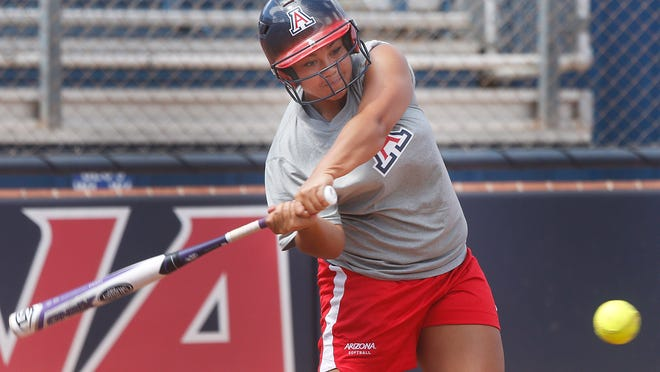 Freshman Katiyana Mauga takes a cut during batting practice at Arizona Wildcats softball practice on Tuesday, May 20, 2014, at Hillenbrand Stadium at the University of Arizona in Tucson. Preparations are underway for Arizona's appearance in this week's Super Regional on the road to the Women's College World Series. Photo by Mike Christy / Arizona Daily Star