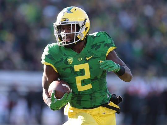 Nov 27, 2015; Eugene, OR, USA; Oregon Ducks wide receiver Bralon Addison (2) runs the ball into the red sone against the Oregon State Beavers at Autzen Stadium. Mandatory Credit: Scott Olmos-USA TODAY Sports