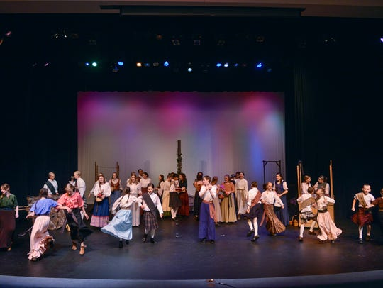 The townspeople of Brigadoon dance during a dress rehearsal