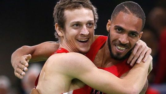 Bronze medalist Erik Sowsinki, left, and gold medalist Boris Berrian after Saturday's 800-meter World Indoor final.
