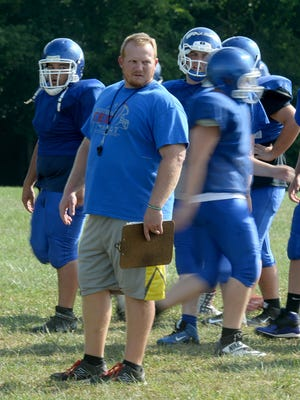 Centerville High School football Coach Kyle Padgett leads practice Friday, Aug. 5, 2016 in Centerville.